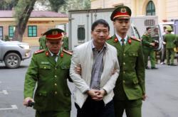 Trinh Xuan Thanh při příchodu k soudu