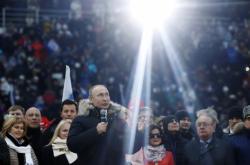 Putinova předvolební akce na moskevském stadionu Lužniki