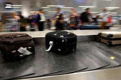 Pás se zavazadly na letišti na Islandu