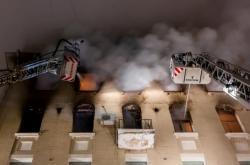 Zásah v hořícím bytovém domě v centru Moskvy
