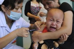 Očkování proti spalničkám v Číně