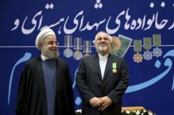 Hasan Rouhání a Mohammad Džavád Zaríf