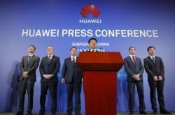 Představitelé firmy Huawei oznámili podání žaloby na vládu USA
