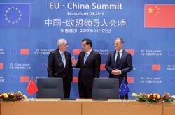 Jean-Claude Juncker, Li Kche-čchiang a Donald Tusk (zleva)
