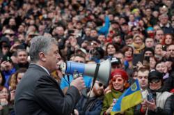 Petro Porošneko na kyjevském stadionu Olimpijskyj