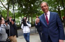 Nigel Farage má po eurovolbách důvod k úsměvu