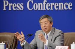 Guvernér čínské centrální banky (PBOC) Yi Gang