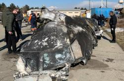 Trosky sestřeleného ukrajinského letadla