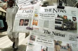 Noviny informující o odsouzení Šajcha na doživotí (červenec 2002)