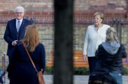 Německý prezident Frank-Walter Steinmeier společně s kancléřkou Angelou Merkelovou