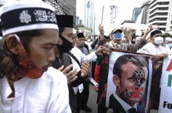 Protesty proti Macronovi v Indonésii