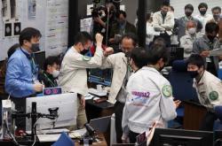 Vědci oslavují návrat kapsle se vzorky
