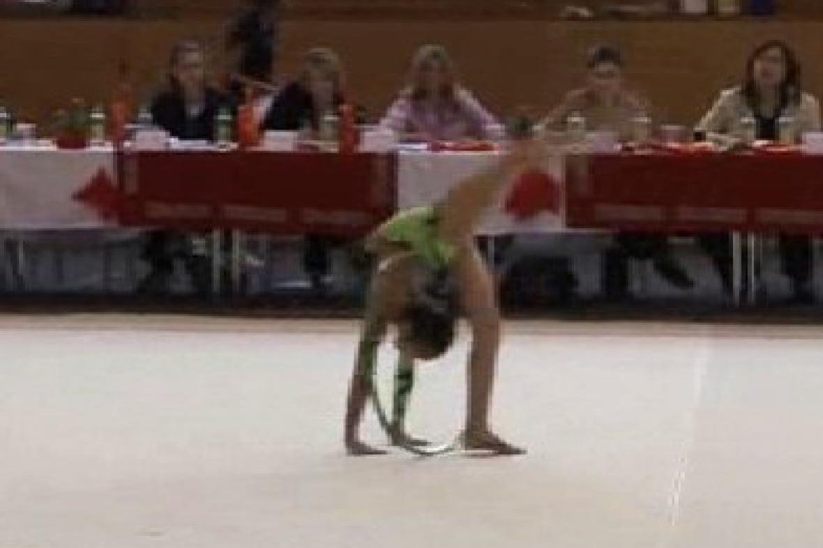 Gymnastka při soutěžním vystoupení
