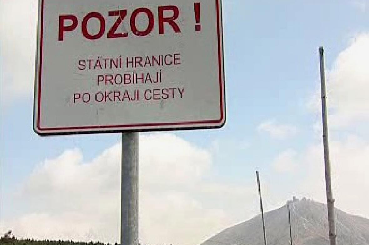 Cedule informující o státní hranici