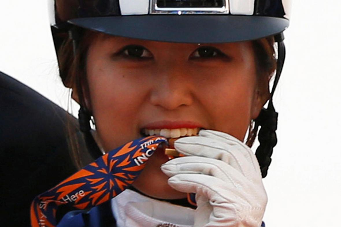 Čchung Ju-ra byla členkou úspěšného týmu drezury z Asijských her 2014