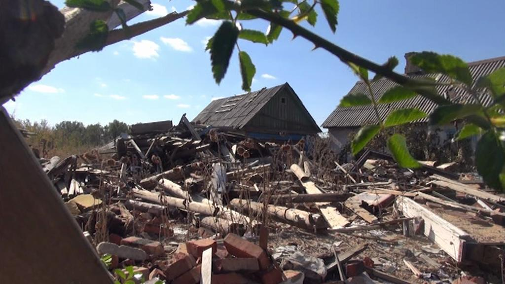 Trosky domu, v němž byla Taťána zraněna