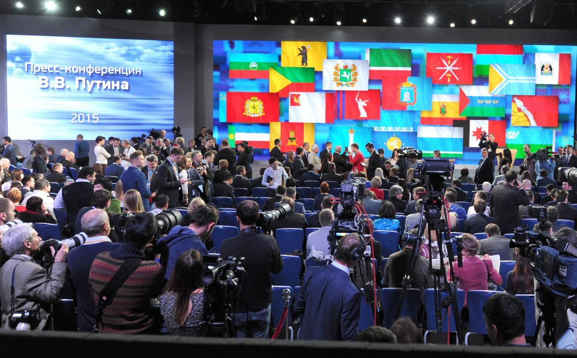 Novináři před tiskovou konferencí s ruským prezidentem