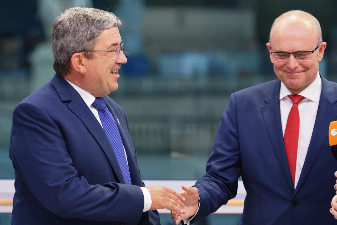 Předseda zemské vlády Erwin Sellering (SPD) a předseda místní CDU Lorenz Caffier
