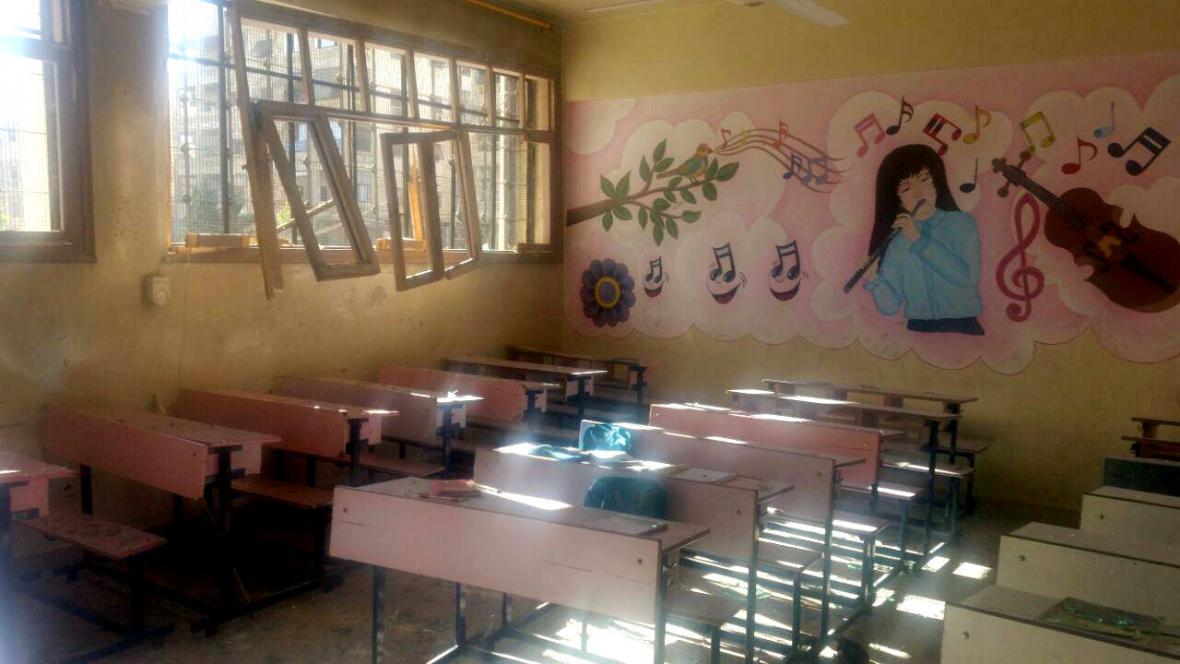 Zničená škola v západním Aleppu
