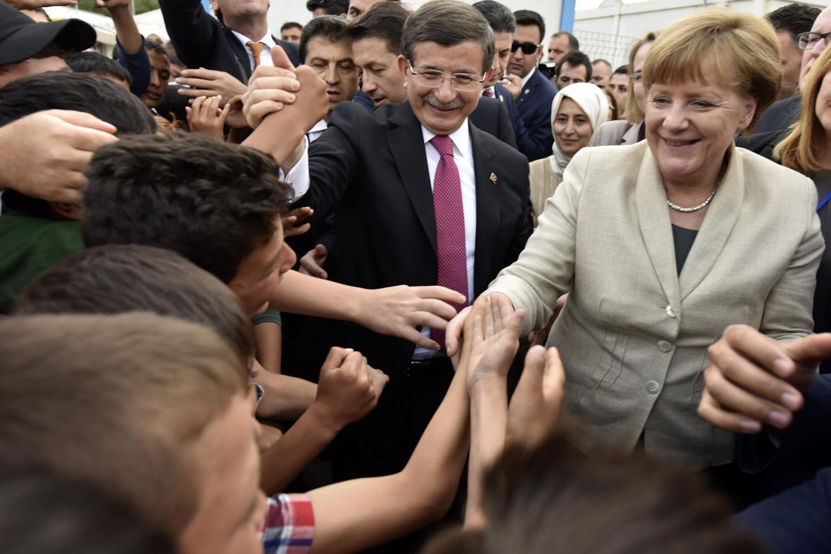 Angela Merkelová s uprchlíky v Turekcu
