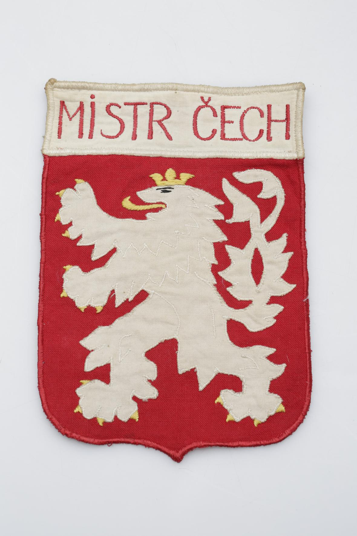 Textilní nášivka Mistr Čech (před rokem 1918)