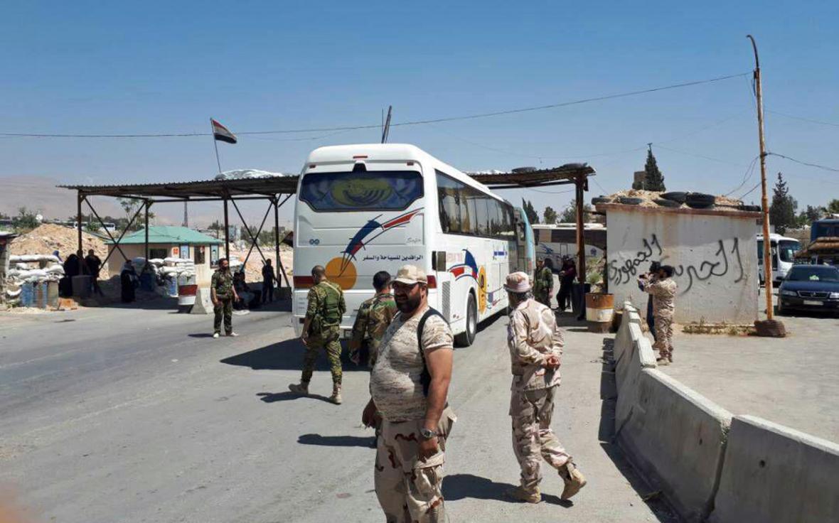Evakuace povstalců ze syrské Ghúty