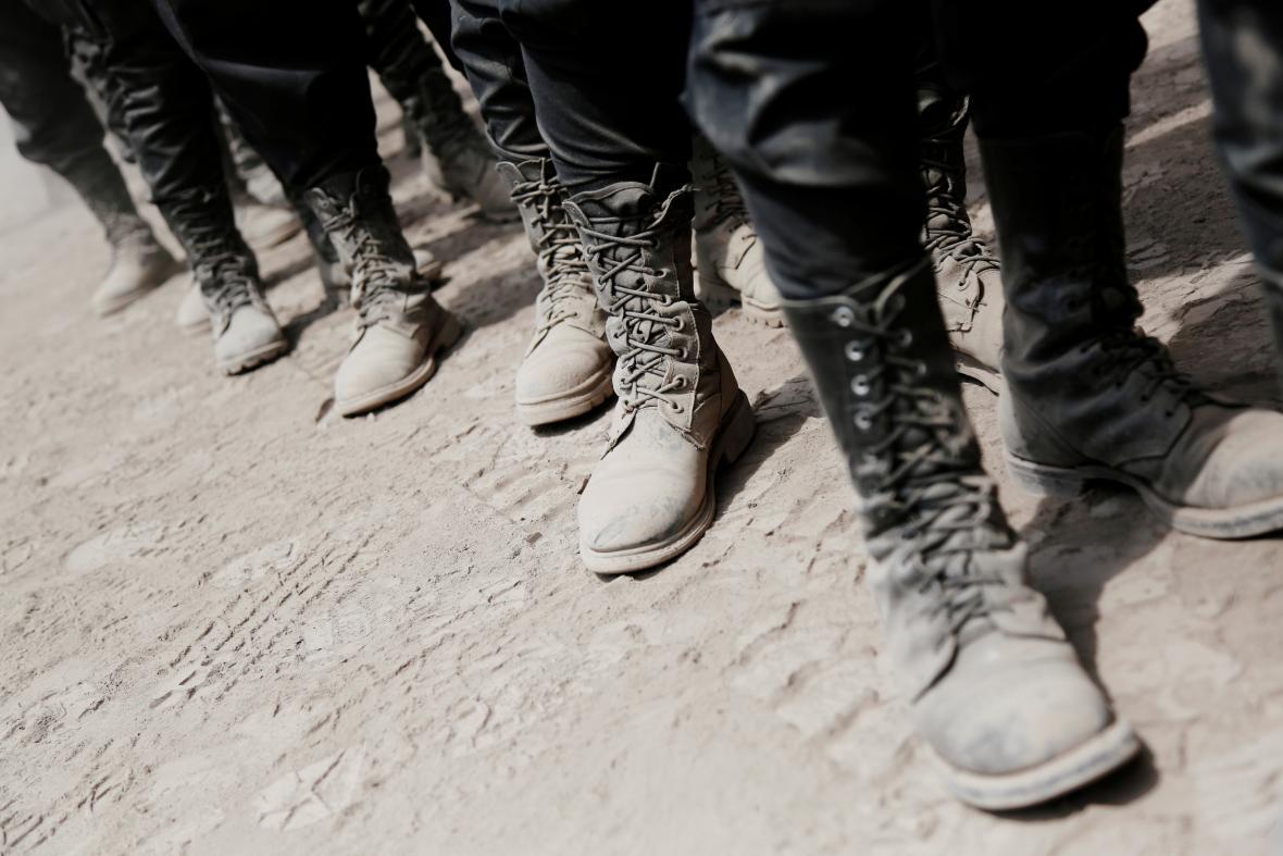 Boty záchranářů od sopečného popela