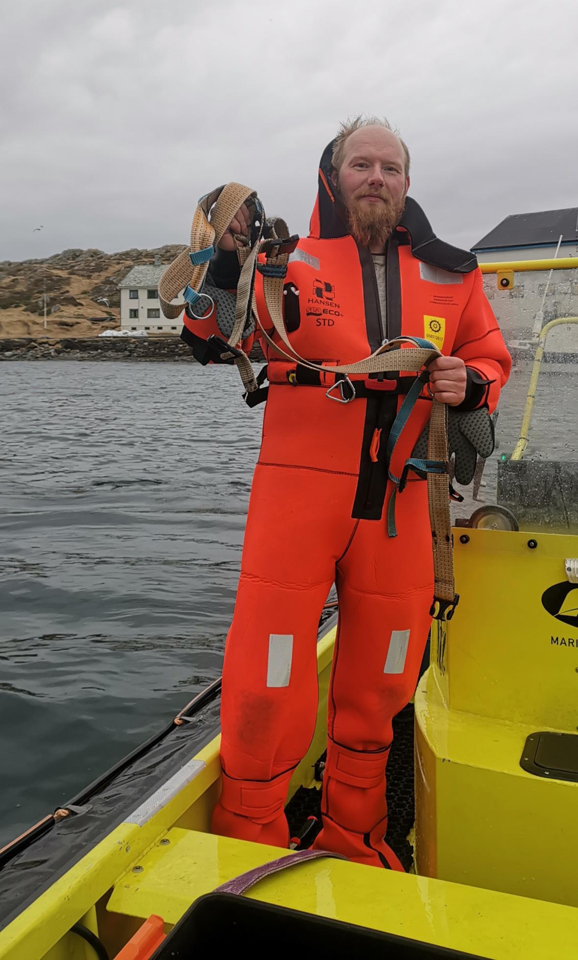 Norský rybář s popruhem z běluhy