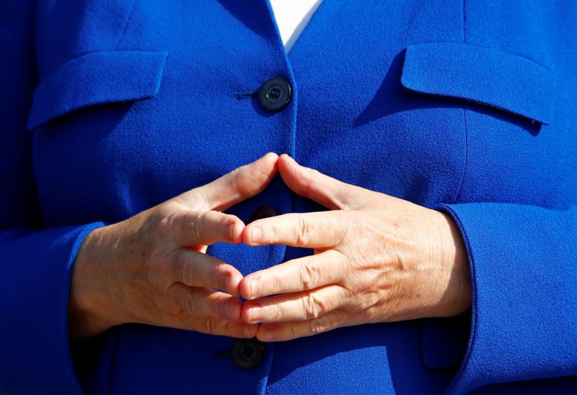 Ikonické gesto kancléřky Merkelové