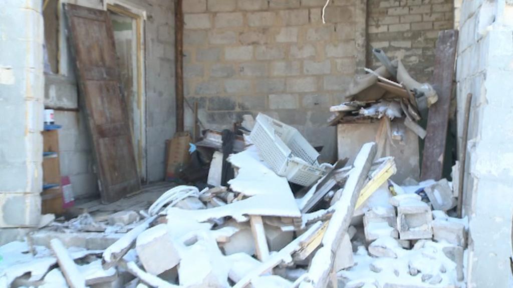 Zničené domy na Ukrajině