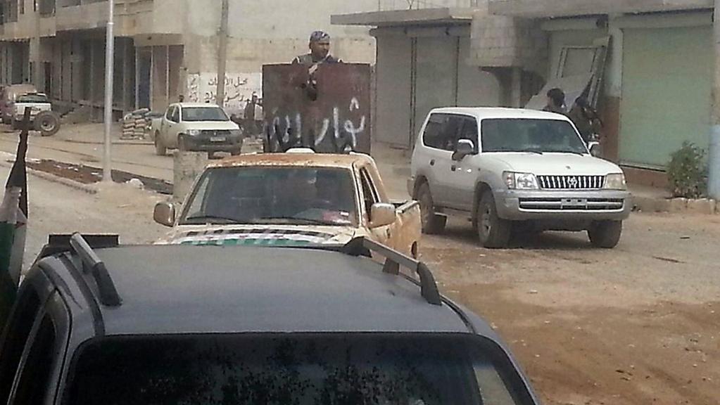 Kurdští ozbrojenci v centru Kobani