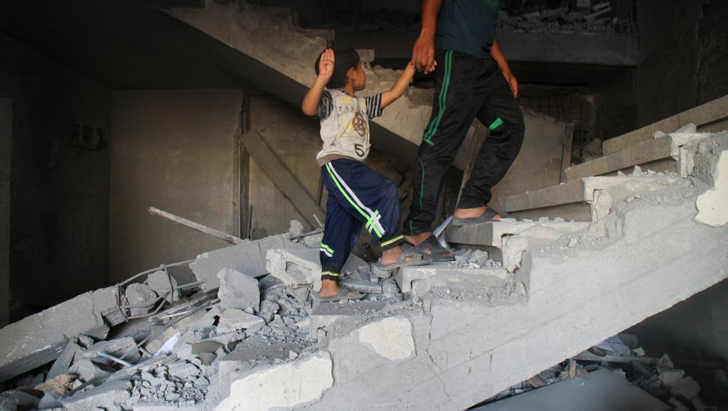 Polorozpadlé domy v Pásmu Gazy