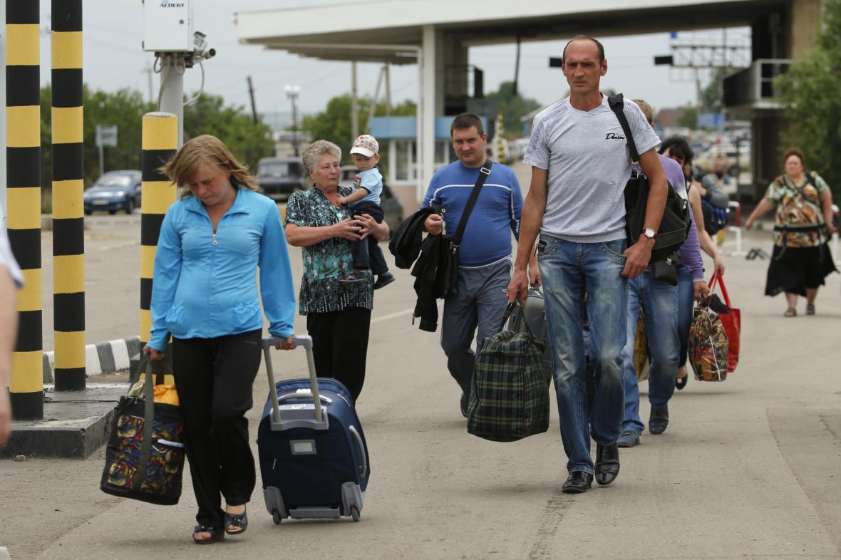 Lidé odcházejí z Ukrajiny