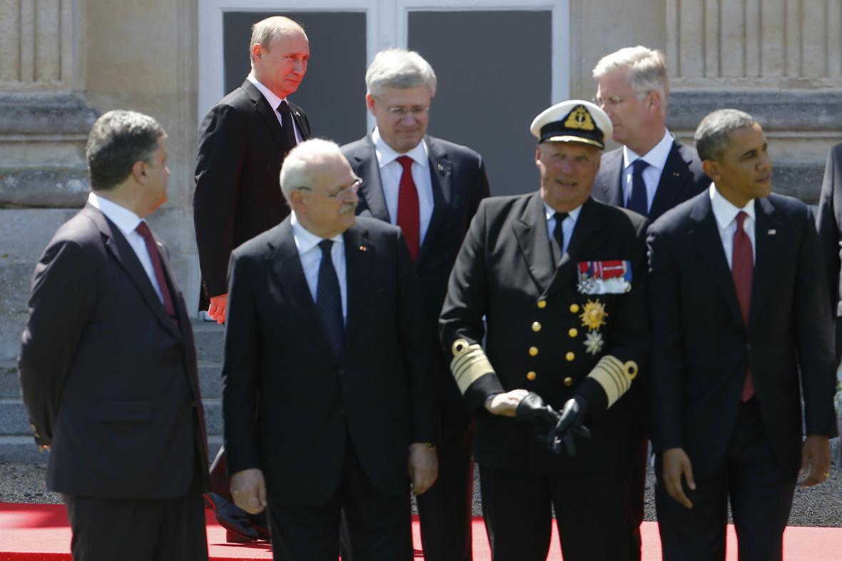 Putin čelí v Normandii vlažnému přijetí