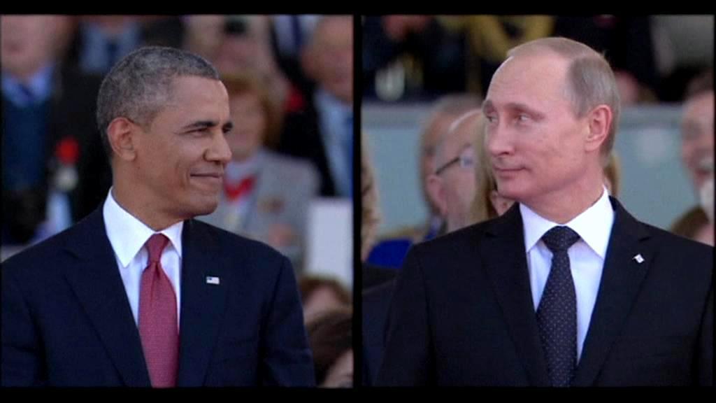 Barack Obama a Vladimir Putin na oslavách Dne D