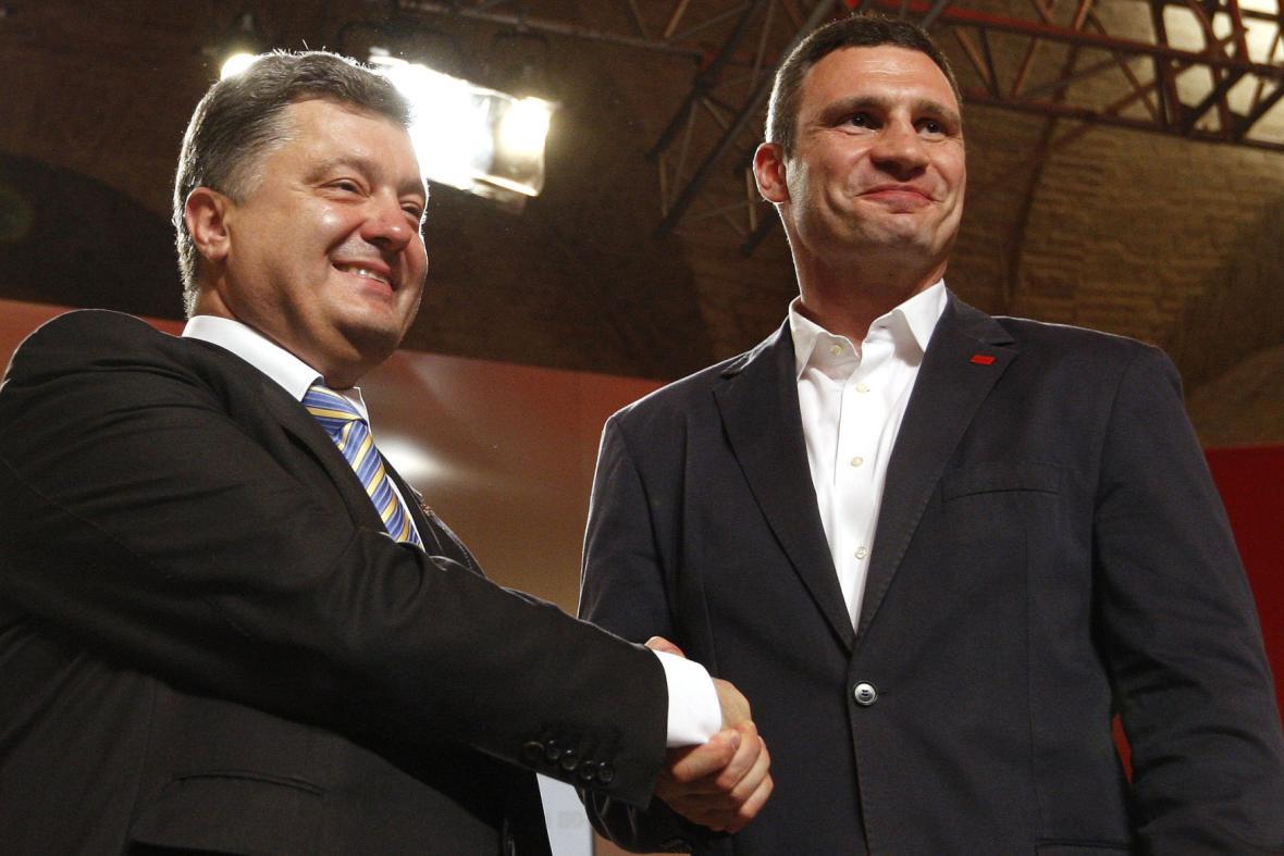 Kličko a Porošenko po úspěšných volbách