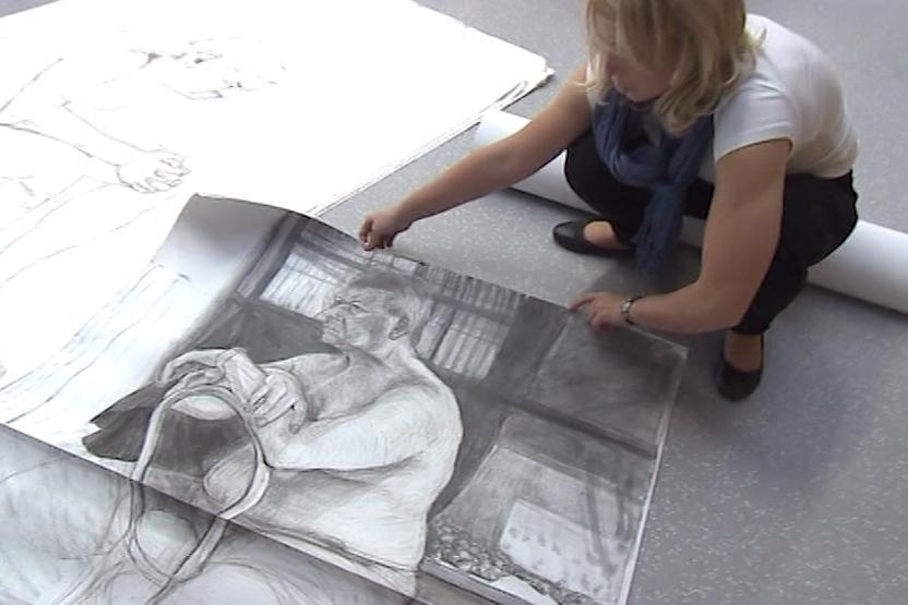 Animátorka se svými kresbami
