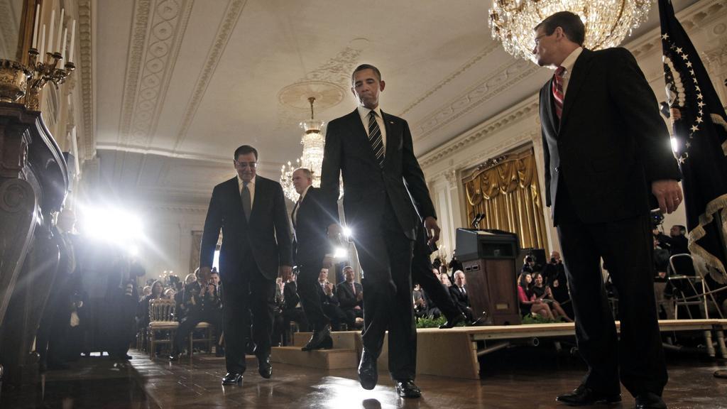 Barack Obama v doprovodu špiček CIA