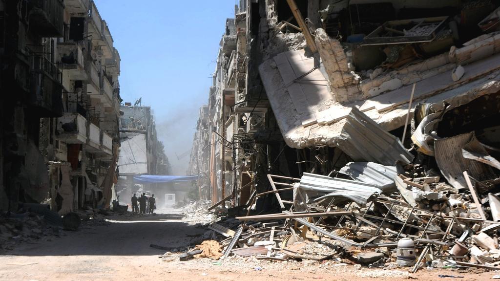 Následky vleklých bojů v syrském Homsu