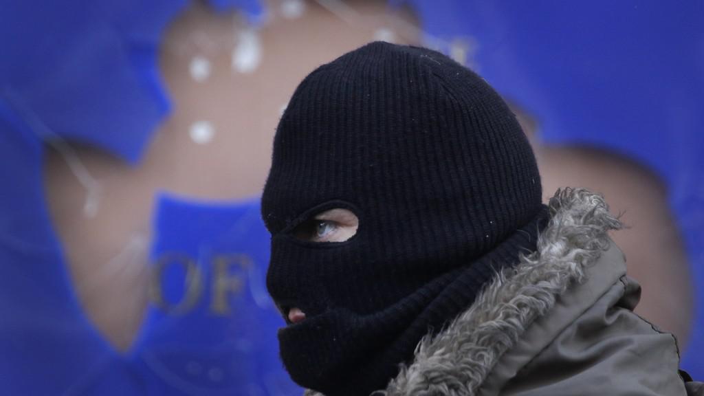 Demonstrant před kyjevským ministerstvem spravedlnosti