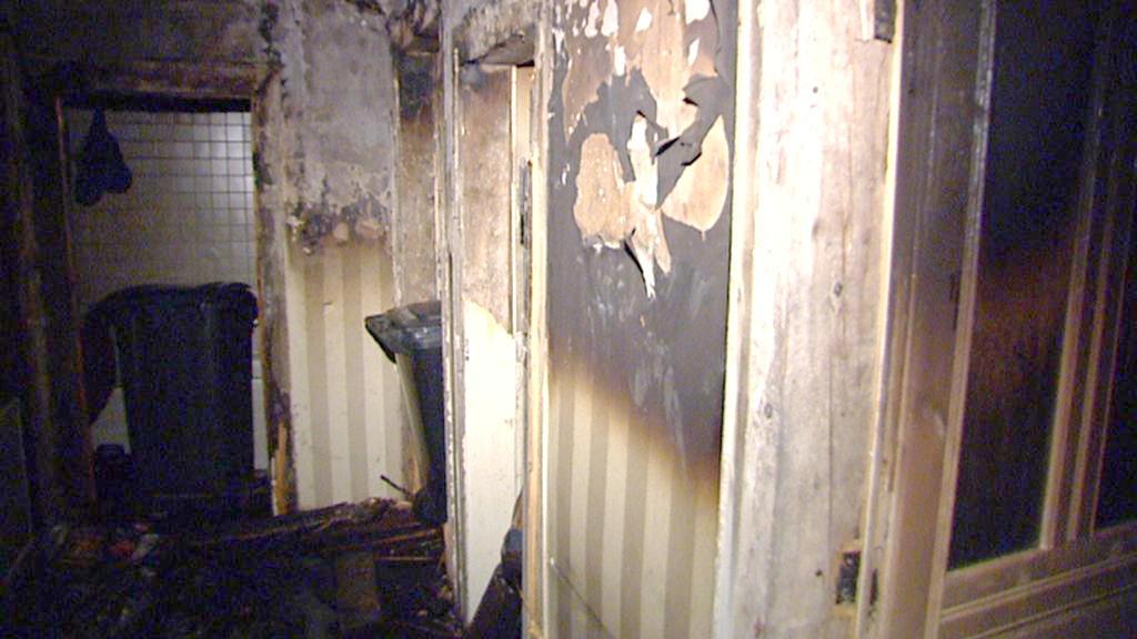 Následky požáru v domě v Kozí ulici