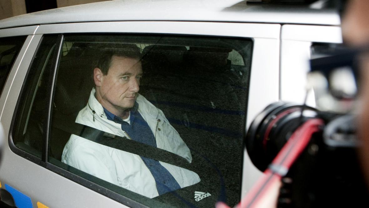 David Rath v policejním autě