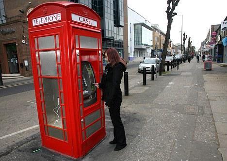 Telefonní budka - bankomat