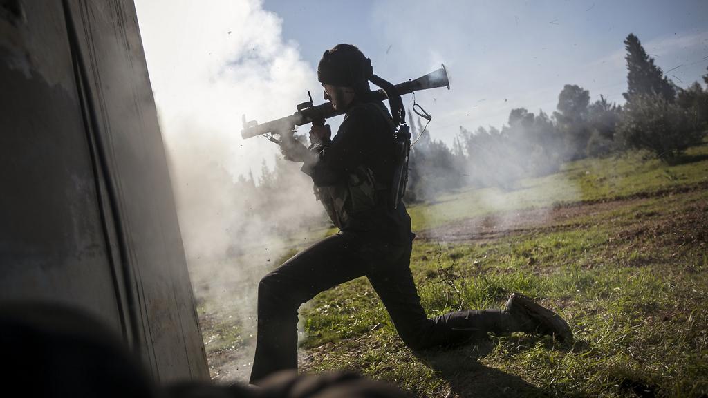 Povstalecký bojovník v Sýrii