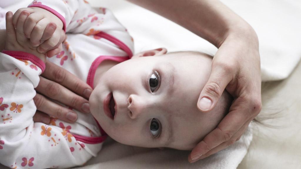 Dítě v kojeneckém ústavu