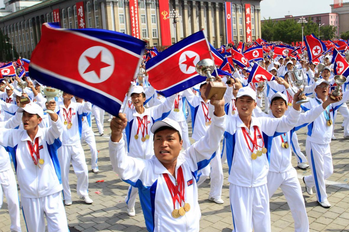 Přehlídky se zúčastnili i severokorejští sportovci