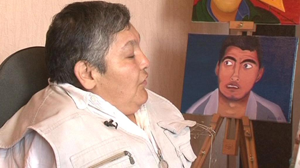 Karipbek Kujukov se svým plátnem