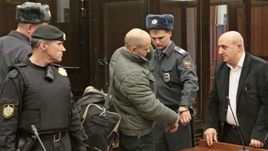 Dmitrij Pavljučenkov před soudem