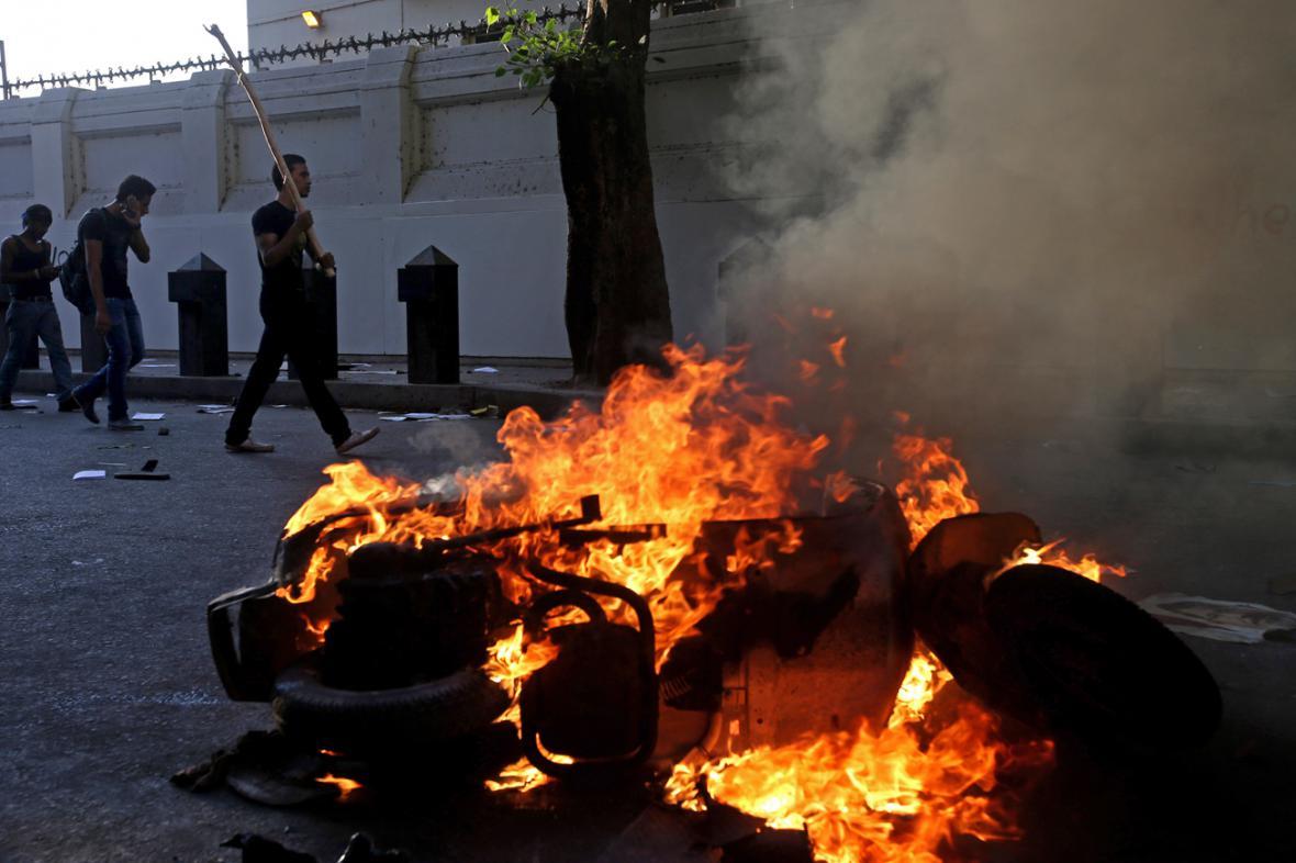 Střety mezi stoupenci a odpůrci Mursího provázely násilnosti