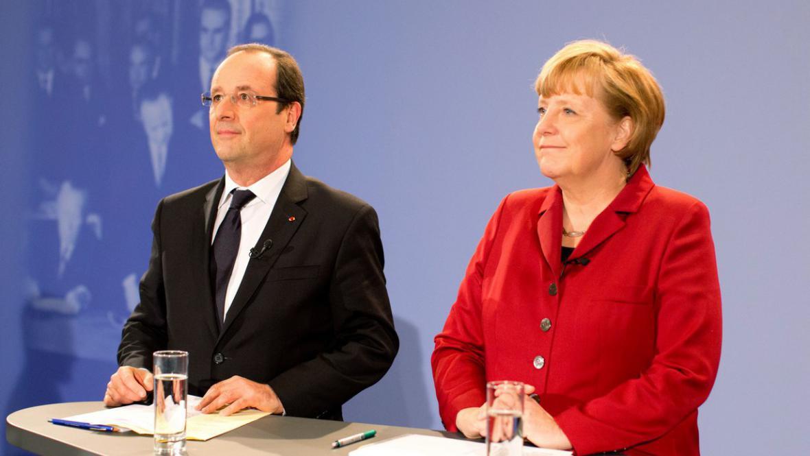 Angela Merkelová a Francois Hollande na konferenci k 50 letům od podpisu Elysejské smlouvy
